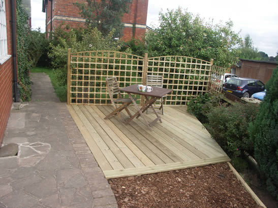 Terrace decking seating with windbreak screen, Hereford