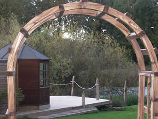 Archway, path to cantilevered timber jetty, Ledbury